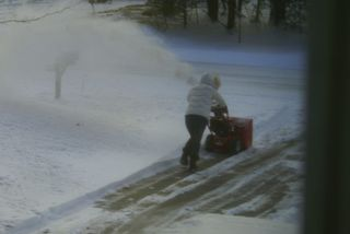 Meg blowing snow on her own 2