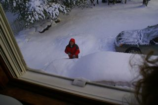 G about to clear snow off of Jeep