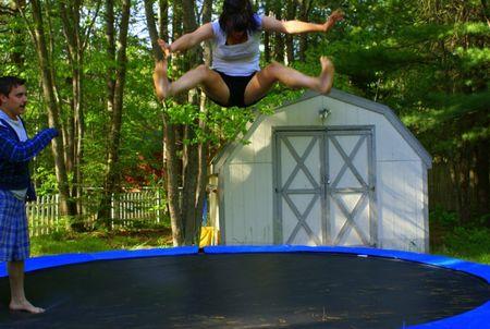 Meg doing splits midair on tramp