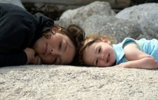Meg_and_gaby_laying_on_rock_uto